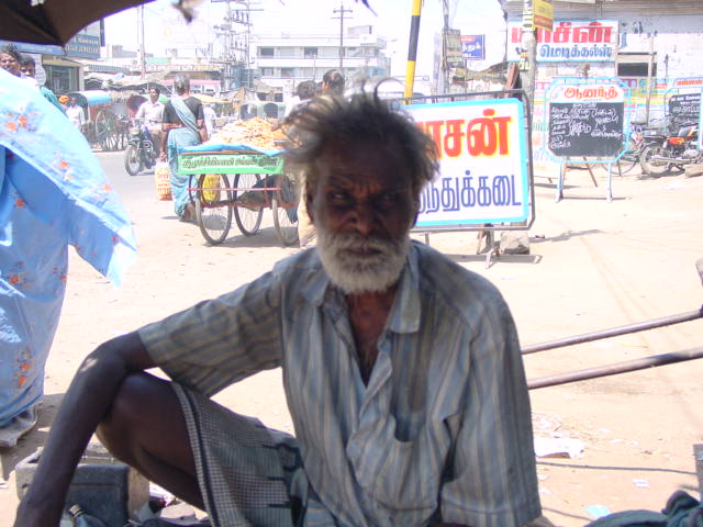 This old man is begging in the street to earn for food
