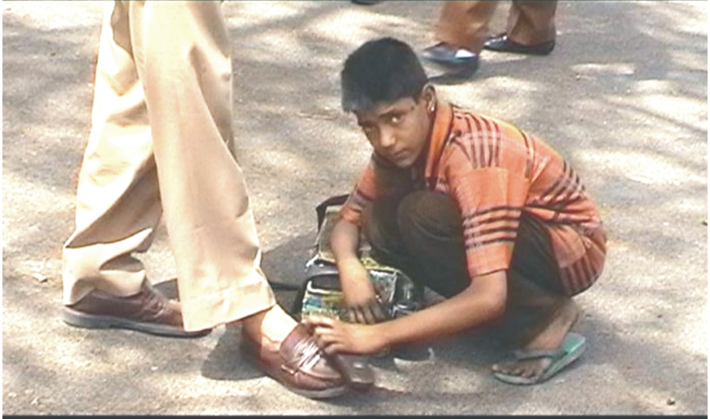childlabour with profession of shoe polish