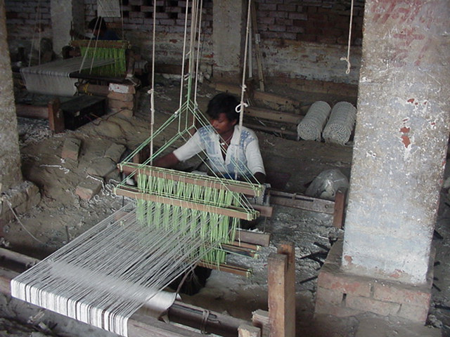 17 year boy weaving floor rug