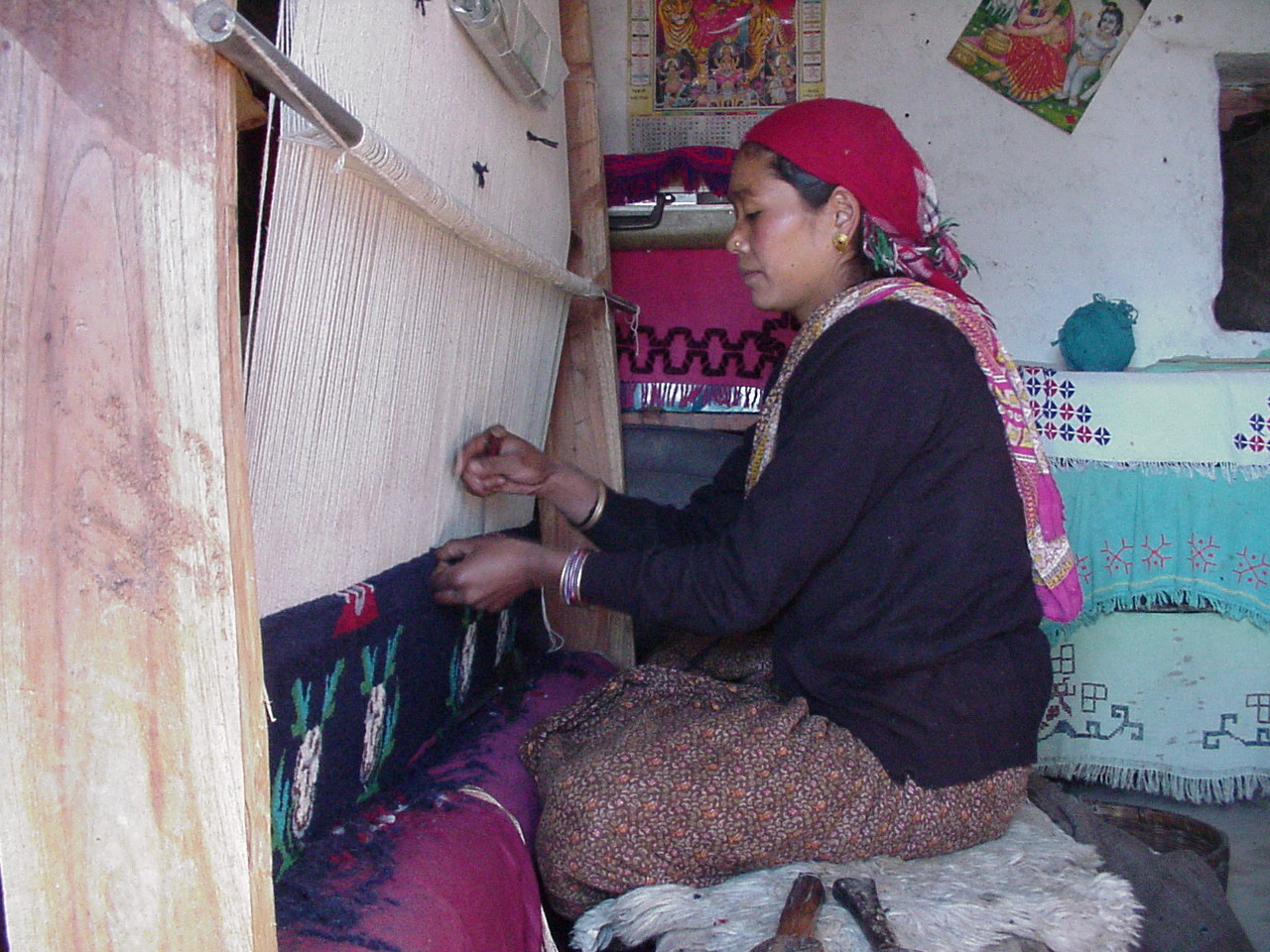 woman knotting carpet