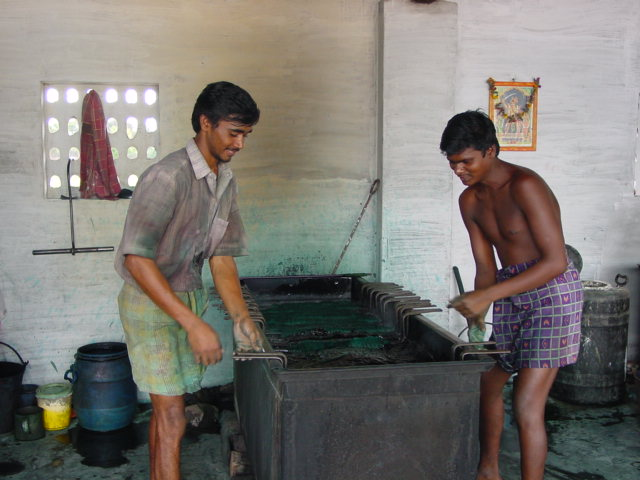 YARN DYEING PROCESS INVOLVES TWO WORKERS AT LEAST